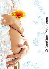 waiting with snowflakes - pregnant woman holding her belly...