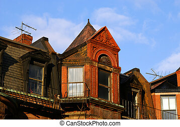 victorian - ornately carved eves of row houses on newbury...