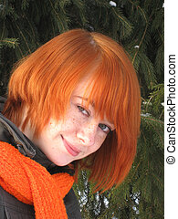 Red-haired girl with orange scarf and green fir