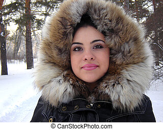 winter - The girl in winter clothes in snow forest...