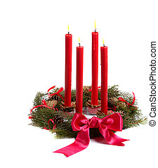 Christmas wreath with red candles and pine cones isolated on...