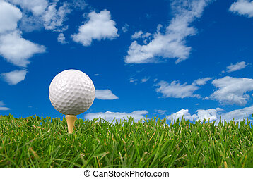 Golf ball close-up from the ground level with grass and...