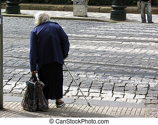 Old Woman Crossing road - A general view of the old town...