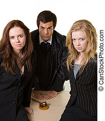 Legal team - Portrait of two women lawyers sitting in front...