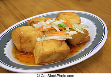 Fried tofu - Chinese cuisine dish of fried tofu in gravy
