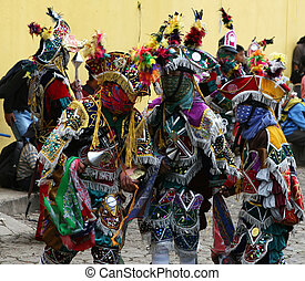 Festival Dancers - Mayan dancers entertain the locals in...