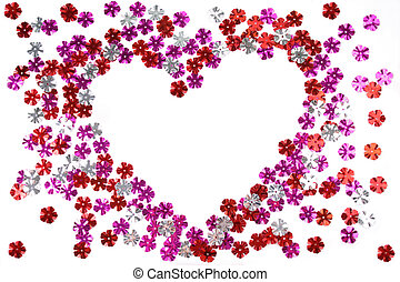 Heart made from the confetti of the flower form
