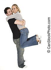 Couples - Studio photograph of young Caucasian couple posing...