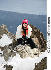Girl in winter mountains - Happy young girl on the top of...