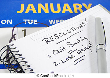 New Years Resolutions - A calendar opened to January with...