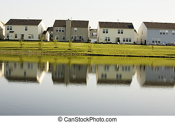 houses on lake - Here is a photo of a row of houses in a...