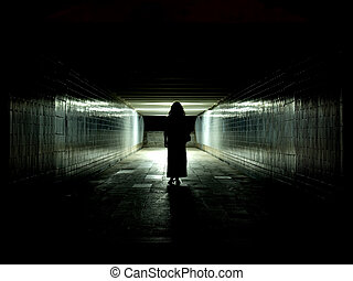 Light at the end of the tunnel - The woman silhouette in the...