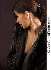 Portrait beauty girl dressed in leather jacket