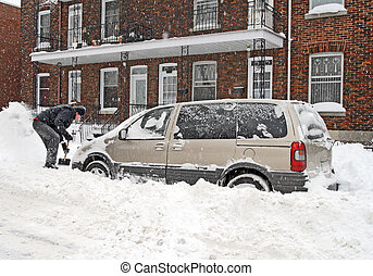 Man removing snow - Man shovelling and removing snow from...