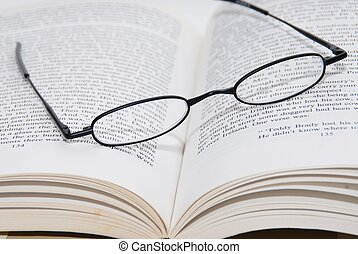 Glasses on Book - A pair of reding glasses on a book.