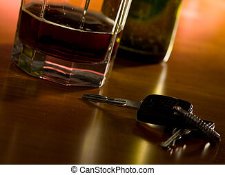 alcholism - A set of car keys and glass of beer on a...