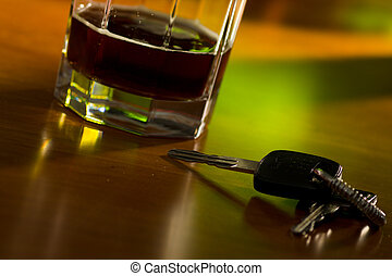 Drink and drive - A set of car keys and glass of beer on a...