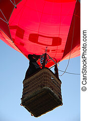 Man and hot air balloon - A man is standing in his hot air...