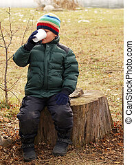 boy drinking cocoa