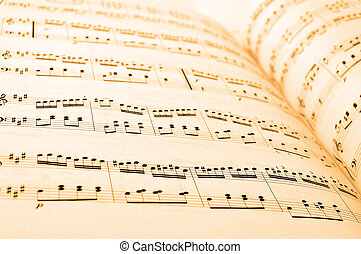 Sheet music - Close-up of sheet music in yellow lighting