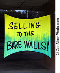 Selling to the Bare Walls - A window sign adverting that the...