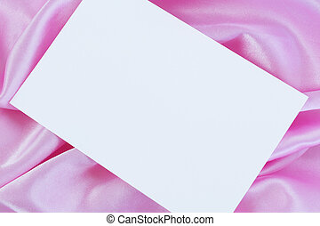 White blank card on pink