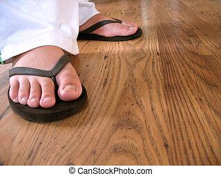 flip flop feet - A closeup of a womans feet wearing some...