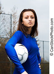 Soccer player - A shot of a soccer player carrying a soccer...