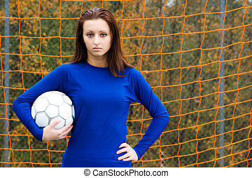 Soccer player - A beautiful soccer player carrying a soccer...