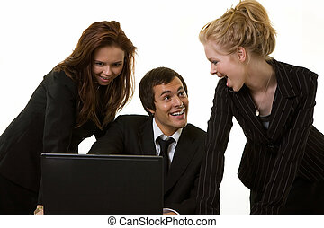 Team work - One business man sitting at desk in front of a...