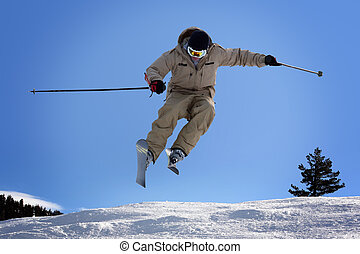 Skiing - Skier jumping at Lake Tahoe, California resort