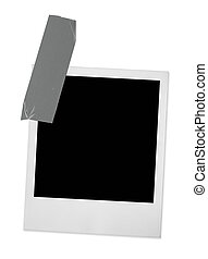 single photo frame taped, minimal shadow behind