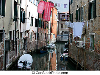 Venice Canal - Colorful Venetian canal with laundry drying