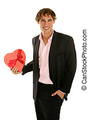 Valentine Date and Heart - Handsome young man holding a...