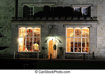stately home windows and door lit at night - old stately...
