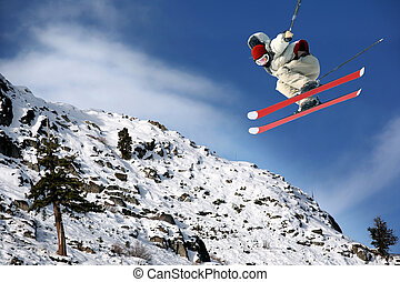 Skiing - A young man jumping high at Lake Tahoe resort