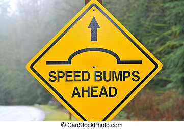 slow down - caution sign for speed bumps ahead