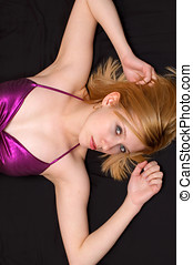 Blonde over black - Attractive blonde posing over a black...