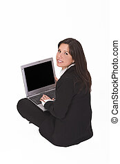 Businesswoman with laptop - Businesswoman sitting with a...