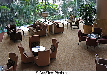 Cafe lounge - Elegant cafe lounge waiting area with tables...