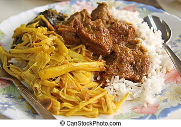 Curry and rice - Traditional dish of spicy indian curry with...