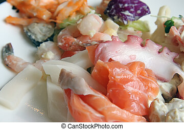 Fresh sashimi platter featuring octopus salmon and prawns