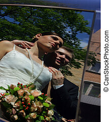 Bride and Groom Reflection - A portrait of a bride in a...