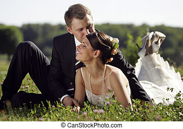 Bride and Groom being romantic - A portrait of a bride in a...