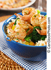 Grilled shrimps with rice and vegetables