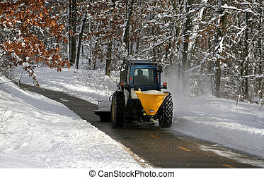 Snow Plowing - snow plowing machine cleaning the bike trail...