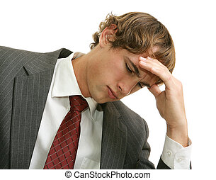 Overwhelmed with Job Stress - Young businessman overwhelmed...