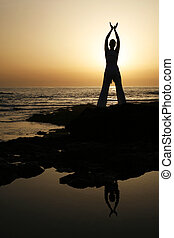 Sunset Yoga - Woman doing yoga at sunset