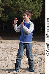 Boy playing with opened hands