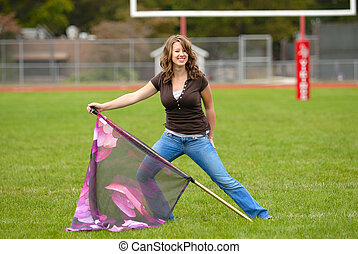 Color Guard Practice - Young woman practicing her color...